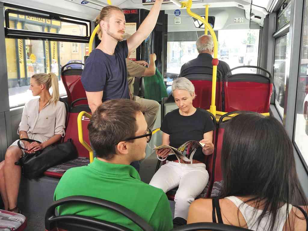 """In unseren Bussen sind Sie immer """"mit Klima"""" unterwegs."""